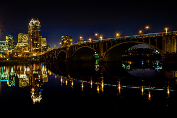 Mississippi Mirror - The unseasonably calm waters of the Mississippi river in downtown Minneapolis reflect the city skyline and the sweeping curve of the 3rd Avenue Bridge on this November evening.