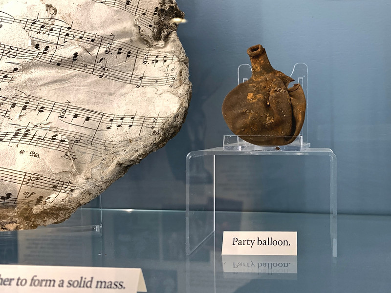 Artefacts: party baloon and music manuscript