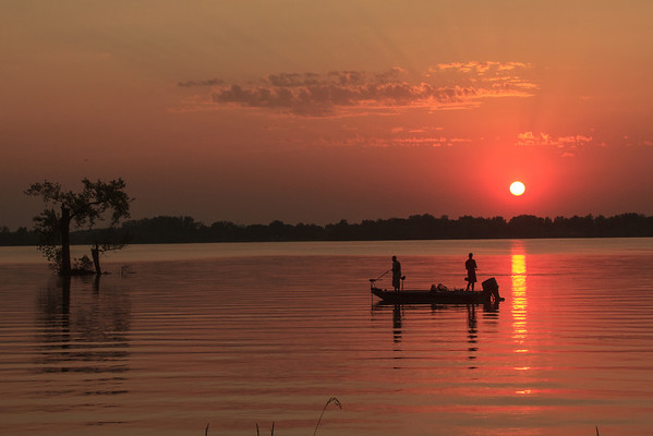 Fishermen end the day under the red sun on Centerville Lake