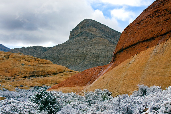 Red sandstone creates a beautiful background to the fresh snow at Red Rock Canyon in Nevada.