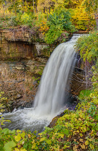 The leaves are beginning to turn in this image of Minnehaha Falls in Minneapolis.