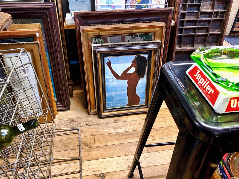 Painting of a nude in a vintage shop