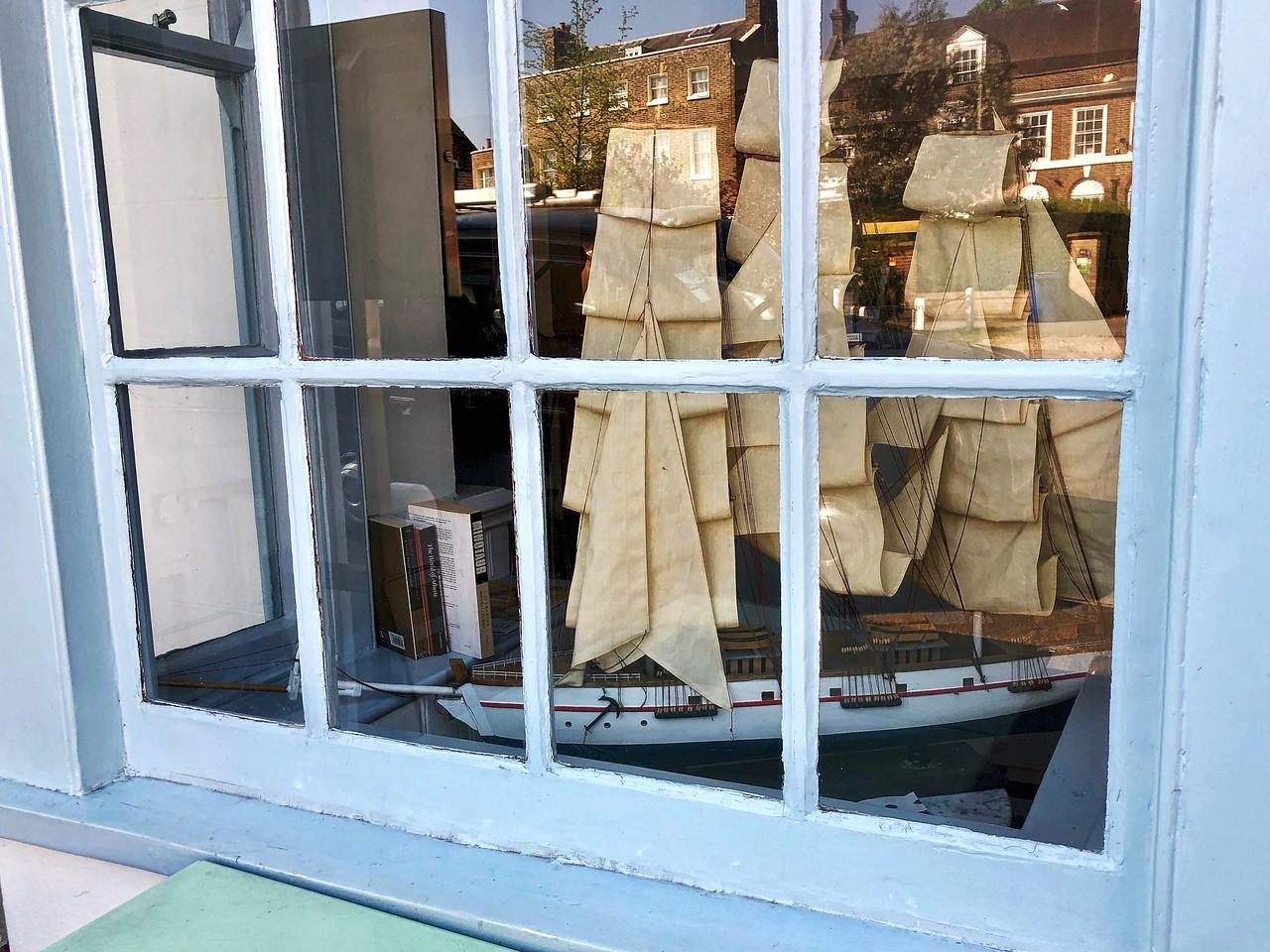 Sailing ship model in a restaurant window in Dulwich Village