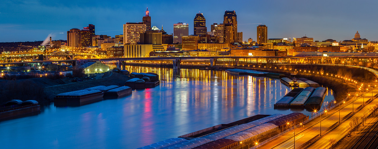 Twilight in Saint Paul - Barges are parked on the mighty Mississippi as the evening descends on the Port of St. Paul in this panorama of the evening skyline.