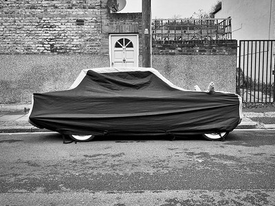 Covered vintage car