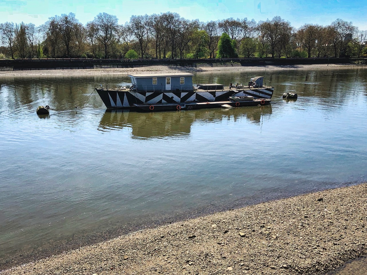 Dazzle boat, low tide at Chelsea Embankment