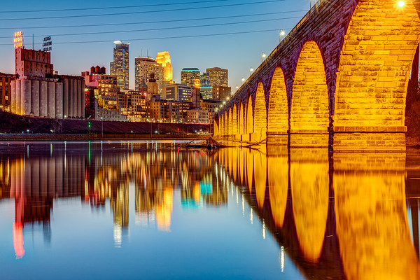 The Stone Arch Bridge and Minneapolis skyline at dusk