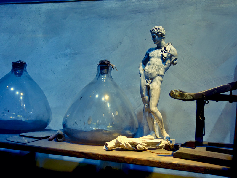 Plaster statue and flasks