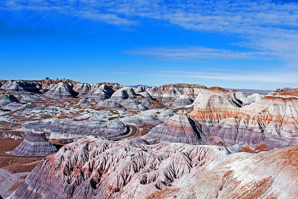 Colorful sediments of bentonite clay and sandstone shape the multi-hued badlands of the Painted Desert at Petrified Forest National Park, Arizona.
