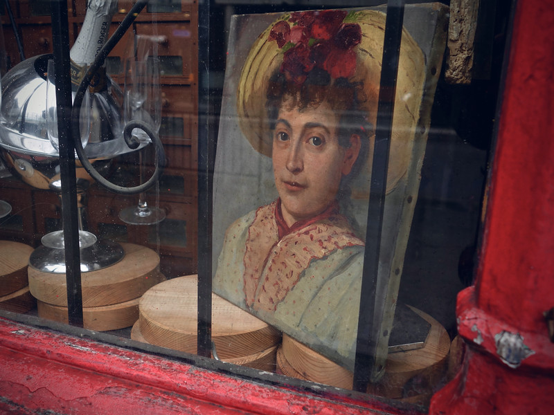 Painting of a woman in an antique shop
