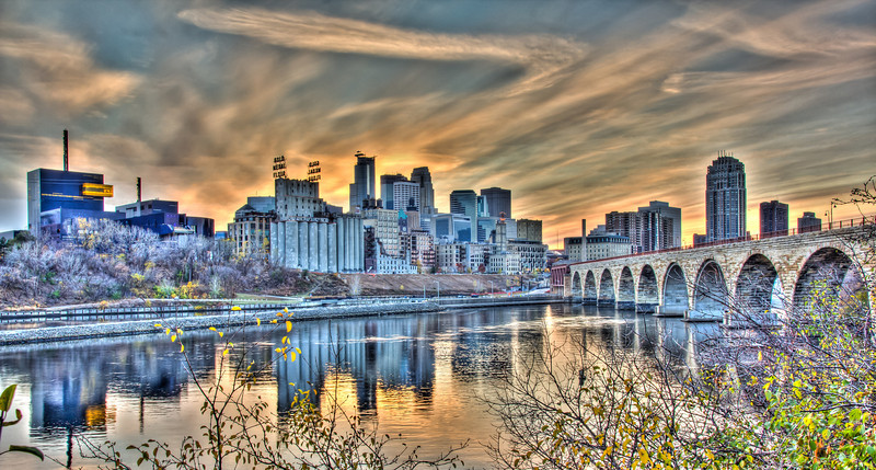 The Minneapolis Riverfront and Stone Arch Bridge get a Gotham-esque look in this sunset image