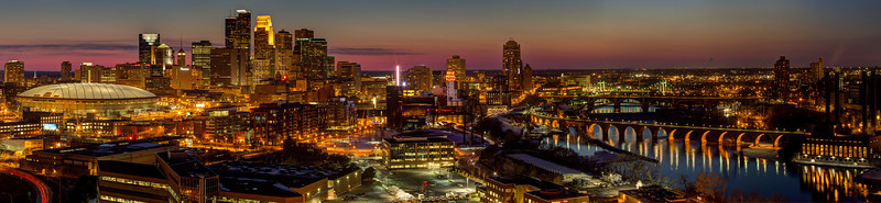 Magenta Minneapolis - This panorama of downtown Minneapolis, captured just after sunset, shows the city skyline in all its night time glory, along with the beautiful bridges over the Mississippi River. From the Metrodome to the historic Stone Arch Bridge, with the city skyline, Guthrie theater, and Mill City Museum in between, this bird's eye view is truly unique - and spectacular!