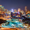 Minneapolis After Dark - This panorama from the Metrodome to the Stone Arch Bridge highlights the city center and the bridges over the Mississippi river just after dark.  The office buildings are still lit up as the workers prepare to head home.