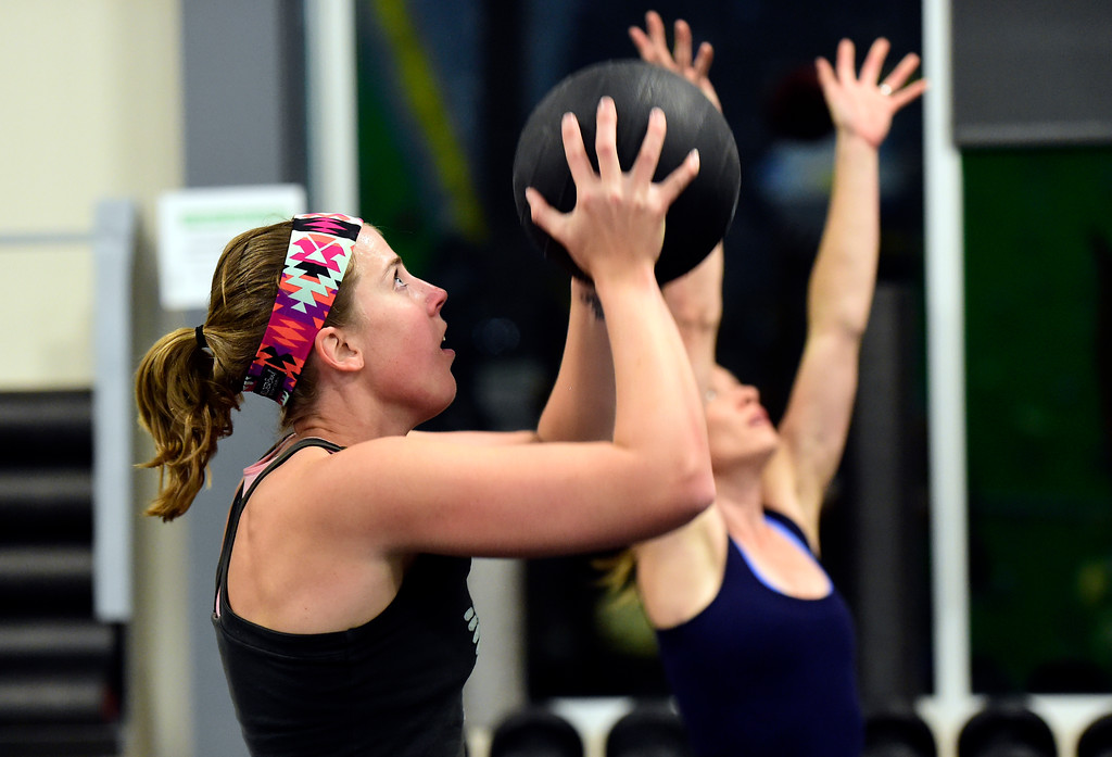 . Laura Gray works out during a Evo HIIT workout on Monday at Evo Rock and Fitness in Louisville. For more photos of the workout class go to dailycamera.com Jeremy Papasso/ Staff Photographer/ Oct. 9, 2017