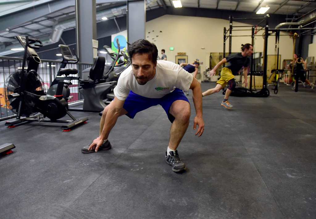 . Jacob Goodman works out during a Evo HIIT workout on Monday at Evo Rock and Fitness in Louisville. For more photos of the workout class go to dailycamera.com Jeremy Papasso/ Staff Photographer/ Oct. 9, 2017