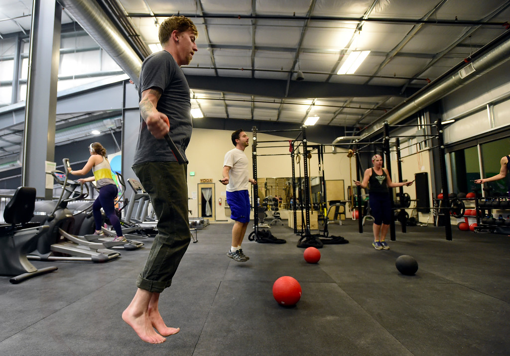 . Brad Berger, at left, works out during a Evo HIIT workout on Monday at Evo Rock and Fitness in Louisville. For more photos of the workout class go to dailycamera.com Jeremy Papasso/ Staff Photographer/ Oct. 9, 2017