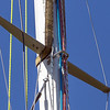 Between the blue line and the red line just below the spreader you can see the forestay....it's staying in place, yay!
