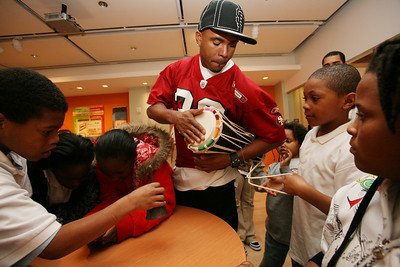 49ers Cornerback Donald Strickland plays African instruments as he visited with children at the Museum of African Diaspora in San Francisco.  35 children from the Bayview and Hunters Point district were selected to be given a tour of the facility and hang out with the football player.  The 49ers will be visiting with more children at the museum through out the month in celebration of Black History Month.