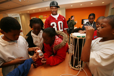 49ers Cornerback Donald Strickland watches kids play with African musical instruments as he visited with them at the Museum of African Diaspora in San Francisco.  35 children from the Bayview and Hunters Point district were selected to be given a tour of the facility and hang out with the football player.  The 49ers will be visiting with more children at the museum through out the month in celebration of Black History Month.
