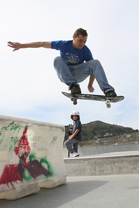 Cody Natalini 22, of Santa Rosa, a skater of 14 years, does an Ollie over a barrier at Pacifica Skate Park next to the Pacifica Community Center.  He says the pool skating at the location is among the best in California.  The park was funded by the 2000 Parks Bond Act.  The location serves to create a positive gathering skating space for skating teens as opposed to infiltrating city streets and causing a hazard to pedestrians.