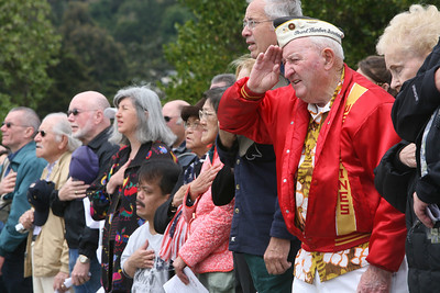 Phil Dresdan, a former Marine, WW2 and Pearl harbor veteran (red) is among many in the crowd during the National Anthem at the 32nd annual Memorial Day observance at Golden gate National Cemetery in San Bruno which was organized by, ÒThe Avenue of Flags CommitteeÓ.  It is a none-profit organization that survives on donations from private individuals. Over 400 people were in attendance and among them were current and former military, dignitaries, family and friends of service members.