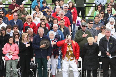 The crowd during the National Anthem at the 32nd annual Memorial Day observance at Golden gate National Cemetery in San Bruno which was organized by, ÒThe Avenue of Flags CommitteeÓ.  It is a none-profit organization that survives on donations from private individuals. Over 400 people were in attendance and among them were current and former military, dignitaries, family and friends of service members.