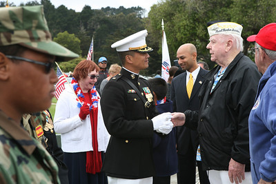 At the 32nd annual Memorial Day observance at Golden gate National Cemetery in San Bruno, HQ Co. Commanding Officer Major Ted Wong shares a moment with Troy J. Morris, former Airforce vetran who was at the Bombing of Pearl Harbor during WW2. The event was organized by, ÒThe Avenue of Flags CommitteeÓ.  It is a none-profit organization that survives on donations from private individuals. Over 400 people were in attendance and among them were current and former military, dignitaries, family and friends of service members.