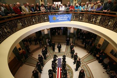 Funeral services for former San Mateo County Sheriff Earl Benjamin Whitmore were held in Courtroom A at the San Mateo County History Museum in Redwood City.  150 family, friends, colleagues and officers were present to pay their respects.  20 members of the SheriffÕs honor guard led by Bob Lewetzon folded and presented the American Flag to wife Beverly Whitmore.  Born on March 1, 1918, Earl died on May 21, 2008 and served as County Sheriff from 1951-1973.
