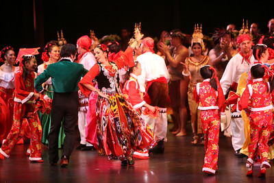 Miriam Peretz (center) dances with Lifetime Achievement Awardee Miguel Santos (green) and the rest of the performers at the close of the event.  The Ethnic Dance Festival began its 1st weekend in celebration of its 30th anniversary at the Palace of Fine Arts Theater in San Francisco.  A total of four weekends which present 36 different ethnic dance ensembles representing cultures from all over the world.  World Arts West whose mission is to promote cultural understanding and to promote a universal appreciation of diverse dance traditions throughout the world presents the event.