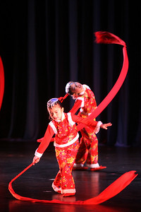"""Children ranging in age from 8 to 12 from CPAA Arts Center perform a dance celebrating the end of winter called, """"Dongbei New Year Celebration"""". The Ethnic Dance Festival began its 1st weekend in celebration of its 30th anniversary at the Palace of Fine Arts Theater in San Francisco.  A total of four weekends which present 36 different ethnic dance ensembles representing cultures from all over the world.  World Arts West whose mission is to promote cultural understanding and to promote a universal appreciation of diverse dance traditions throughout the world presents the event."""