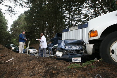 At about 11:50am Jim Loftus (blue jacket) was driving his 1991 Ford Mustang East Bound from Half Moon Bay when a Goodwill truck, which lost control coming in the opposite direction, stuck him. Jim sustained minor injuries to his right hand and knees while being hit in the face by the airbag deployment.  The accident caused congestion on the two-lane highway for about 1.5 hours.