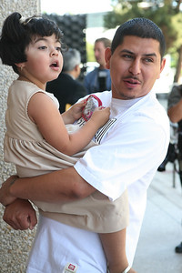 Jose Delgado Jr., brother of defendant  Edith Delgado, holds little Linse (not sure of Spelling or family relation) as the whole family was relieved with the final verdict.