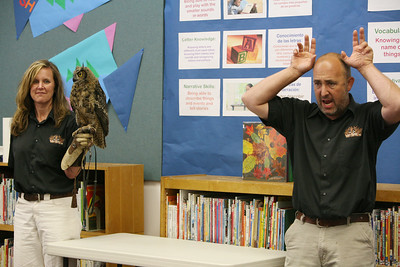 Gabe and Barbi Kerschner show the children Archimedes the Great Horned Owel at the SSF Down Town Library. Wild Things Inc. visited the library with six different wild animals for children and grown ups to see. The organization, which has over 60 species of wildlife, takes in animals that have been rescued from stress situations and for one reason or another cannot return to the wild.  The organization uses these animals to instruct young and old alike about living harmoniously with natureÕs habitat.