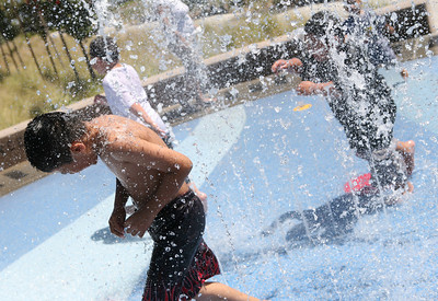 Daniel Garcia of South San Francisco, age 9, who came to the park with his sister and grandmother, plays in the water fountains at Ryder Park in San Mateo.  it is a favorite location for his family on warm days.