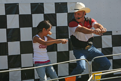 Angelica Quintero 8, mimicks announcer Charlie Boger after winnning a pig nose for supporting the winnning pig in the race.  Pig racing was one of many events that entertained the public at the San Mateo County Fair, which opened its gate Friday for the first time. The Ham Bone Express, which puts on the race, is a traveling show that tours different fairs around the country.  It is their third year of participation in the San Mateo County Fair.  Several races are held, each with different types of pigs competing to be the one to get an Oreo cookie.  Last year over140,000 people visited the San Mateo County Fair and this year attendance is expected to exceed that by 10,000.  The fair runs through Sunday August 19th.