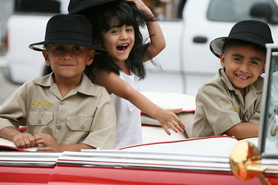"Members of the ""Viejitos Car Club"" in San Jose, Anthony Gonzales age 7, Veronica Gonzales age 3, and Peter Gonzales age 5, all of San Jose, clown around in a classic convertable car before the parade begins.  The San Francisco Carnival is a parade that celebrates the cultural diversity from around the world that comes together in our unique bay area environment. This yearÕs Carnival featured 80 different dance contingents several of which included decorated floats.  The Parade dances through Mission District Streets.  Afterwards there is a street fair with food, music and further Dance Performances."