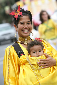 Dawn Williams and her baby boy Pheonix 9 months participate in the parade with Batucada do Leste.  The San Francisco Carnival is a parade that celebrates the cultural diversity from around the world that comes together in our unique bay area environment. This yearÕs Carnival featured 80 different dance contingents several of which included decorated floats.  The Parade dances through Mission District Streets.  Afterwards there is a street fair with food, music and further Dance Performances.