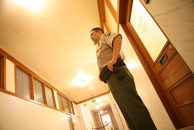 Deputy Sheriff Chin guards the door to the office of Supervisor Ed Jew«s during an F.B.I. investigation.