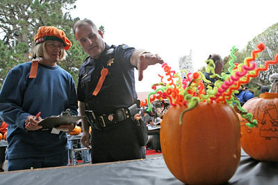 Dr. Jo C. Stroud, D.C. and HMB Police Chief Don O«Keefe judge the public pumpkin carving contest. The Art & Pumpkin Festival celebrated its 37th year over the weekend in Half Moon bay, called the ÒWorld Pumpkin CapitalÓ. Aside from pumpkins on display, the public enjoyed 250 booths with the artwork of local artists, live music, food, local wine and of course pumpkin pie. Activities during the festival included a costume contest, a visit to a haunted house, a pumpkin run/walk, among other things.