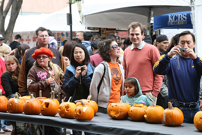 People stop to admire the entries in the  public pumpkin carving contest. The Art & Pumpkin Festival celebrated its 37th year over the weekend in Half Moon bay, called the ÒWorld Pumpkin CapitalÓ. Aside from pumpkins on display, the public enjoyed 250 booths with the artwork of local artists, live music, food, local wine and of course pumpkin pie. Activities during the festival included a costume contest, a visit to a haunted house, a pumpkin run/walk, among other things.