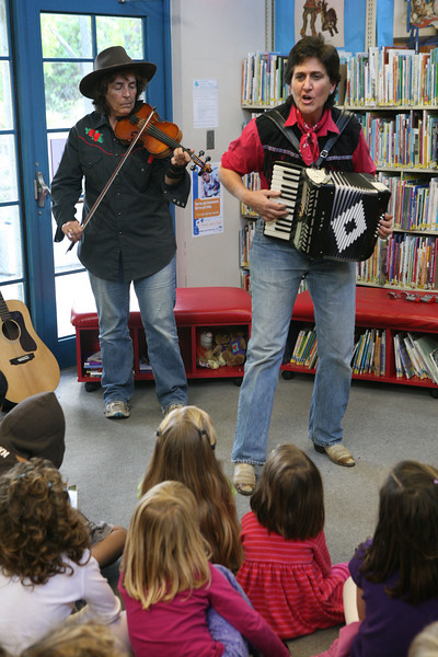 Libby McLarin and Robin Flower came to the Pacifica library as ÒThe Gold Rush SistersÓ.  They played and taught children about different types of instruments used and music heard and life in general during the gold rush era in San Francisco. The sisters played the banjo, accordion and violin among other instruments all the while encouraging audience participation.