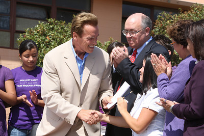 At Sequoia High School in Redwood City, Gov. Arnold Schwarzenegger signs a bill from State Assembly man for Redwood City Joe Simitian which forbids teens from using cell phones and other electronic devices while driving.  Then he shook hands with Ally Colin, ABS President at Sequoia High School.
