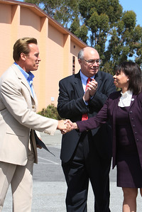 At Sequoia High School in Redwood City, Gov. Arnold Schwarzenegger shakes hands with School Principal Morgan Machbanks before addressing the media snd then signing a bill from State Assembly man for Redwood City Joe Simitian which forbids teens from using cell phones and other electronic devices while driving.