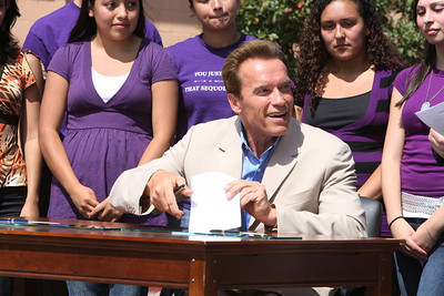 At Sequoia High School in Redwood City, Gov. Arnold Schwarzenegger signs a bill from State Assembly man for Redwood City Joe Simitian which forbids teens from using cell phones and other electronic devices while driving.