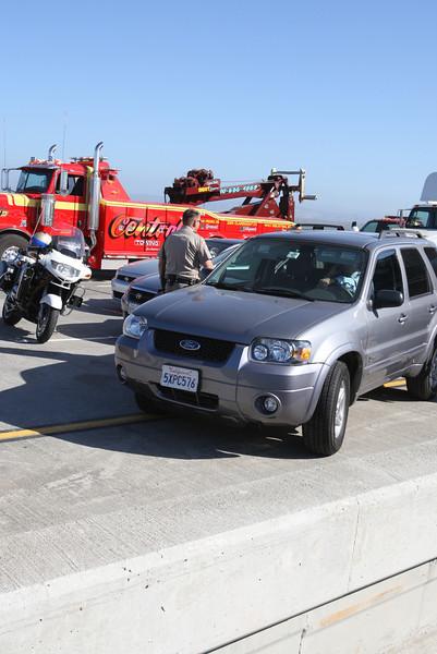 Intermixed with the Emergency responce vehicles were a few civilian vehicles who«s passengers were stuck on the bridge while the sceane was cleaned up.  2 big rigs and one flat bed collided on the San Mateo Bridge west bound.  Know body died but three injuries were reported with one victim transported by helicopter.  Traffic westbound was closed until 11:30am when one lane was re-opened.  Full traffic restored by 1pm.