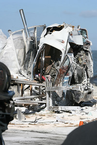 Pictured is the remains of one of the vehicles in the crash.  2 big rigs and one flat bed collided on the San Mateo Bridge west bound.  Know body died but three injuries were reported with one victim transported by helicopter.  Traffic westbound was closed until 11:30am when one lane was re-opened.  Full traffic restored by 1pm.
