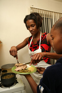 At their apartment in Burlingame, Latosha Smith and her daughter Jyminye Banks 9, prepare and have their dinner together.  They ate canned vegetables and rice with Turkey.