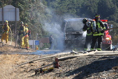 According to Woodside Battalion Fire Chief Kevin Butler, at 3:48 pm, the Woodside Protection District received a call of a vehicle fire on 280 southbound near the Edgwood Rd. exit.  They and Cal Fire responded to the scene, which was upgraded to a ÒWild LandÓ fire as fire from the vehicle spread to the vegetation on the side of the highway.  The Driver of the vehicle Denise Burke experienced vehicle failure while driving Southbound on 280.  As she pulled her dark green 1993 Ford Aero Star mini van to the side of the road, she noticed smoke coming from under her dashboard.  Denise was the only occupant of the vehicle and got out safely.  Bystanders tried to put out the flames but were held back by the driver.  Initial calls to 911 were unsuccessful and the Fire Department was contacted via the operator.  The vehicle was consumed in flames when the firefighters arrived but it and the surrounding area was under control within 10 minutes.  Protective foam was dispersed to prevent a re-kindle of the flames.  No injuries were reported.  Traffic was backed up for a short period of time.