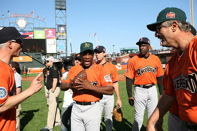 Ricky Henderson and other Celebs mingle after the game.