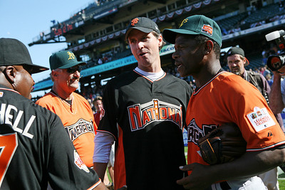 Kevin Mitchell Congratulates Ricky Henderson after the game as mayor Gavin Newsom watches.